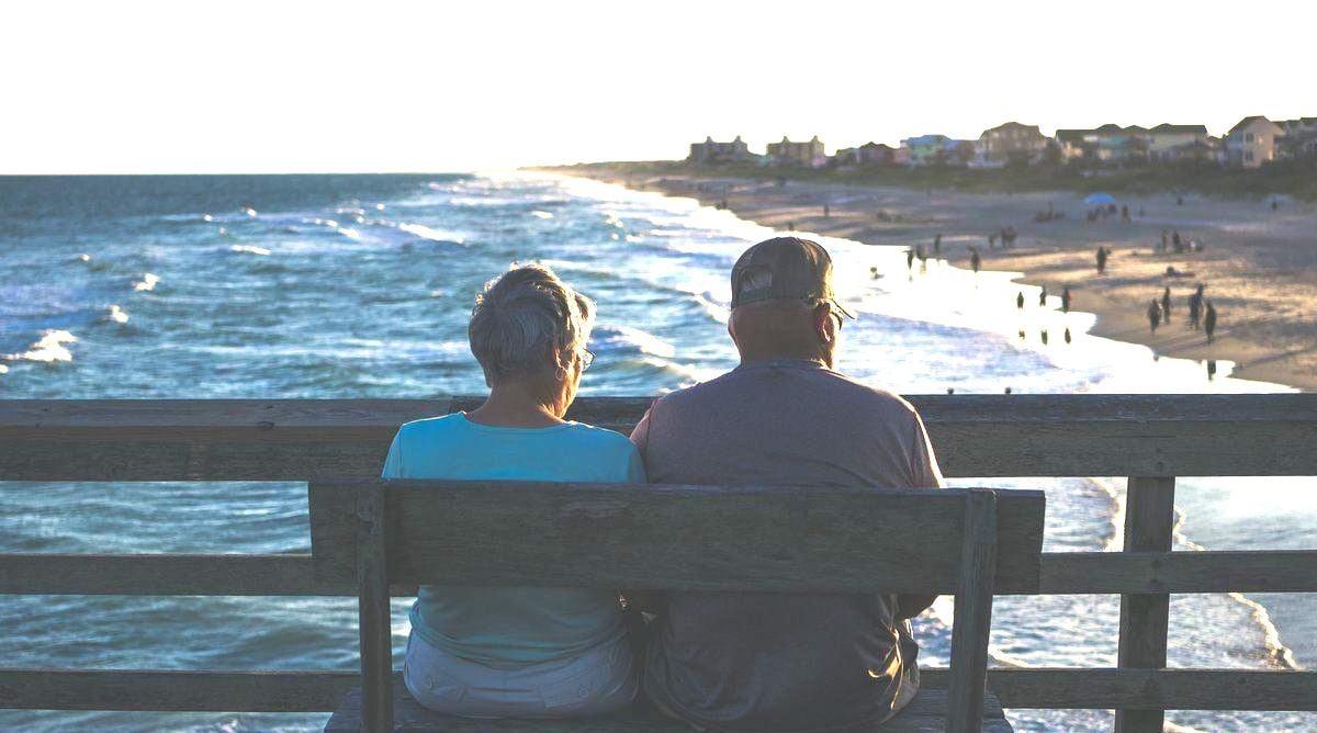lovely older couple enjoying the sunset together
